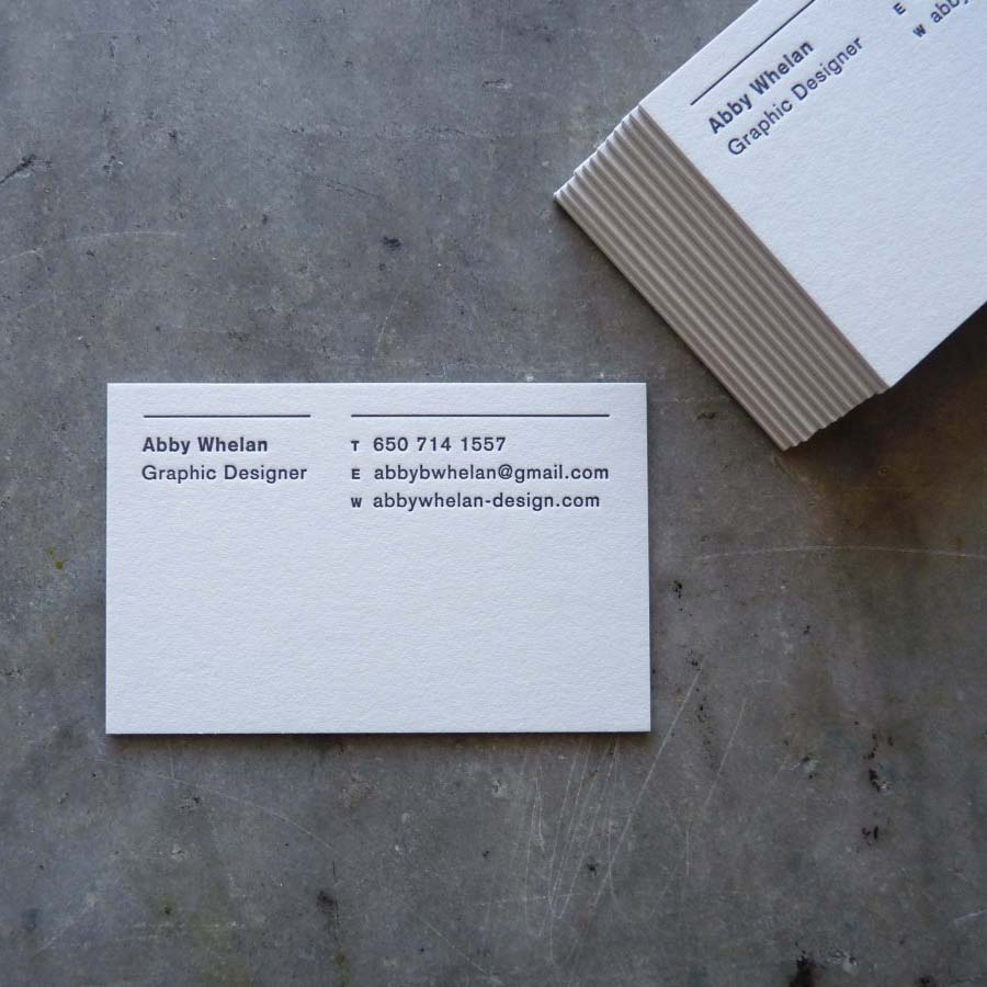 Double-thick letterpress business cards with the name and contact info at the top, below lines, and then a lot of blank negative space below. Clean, minimalist design.