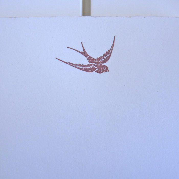Notepad image of bird diving