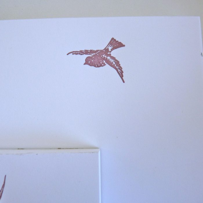 Notepad with image of bird gliding