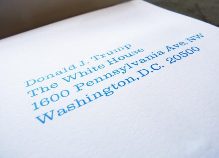 """White postcards letterpress printed with """"Bad Ratings!"""" in blue ink on one side and the president's mailing address on the other side"""