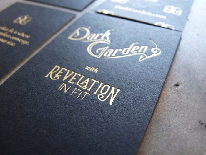 A deluxe black business card / hangtag printed in gold foil, with art nouveau type that evokes the Victorian Era and the natural world.