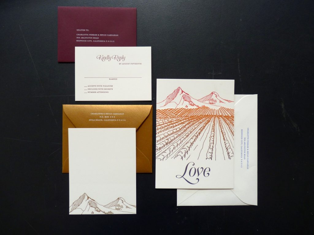 "Carnahan-Ferriari wedding invitation; letterpress printed cards with an ombre effect of sunset colors from reddish to orange/gold and down to purple, with illustration of mountains, vinyard, and the word ""Love"" in large type at the bottom."