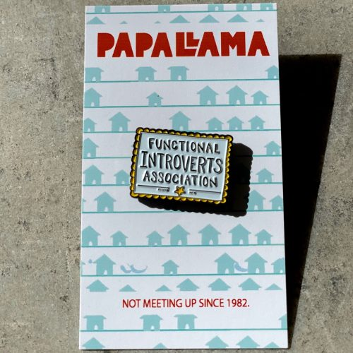 "Soft enamel pin with hand-lettering that reads ""functional introverts association"" on a paper backing that reads ""PapaLlama"" and ""Not meeting up since 1982"""