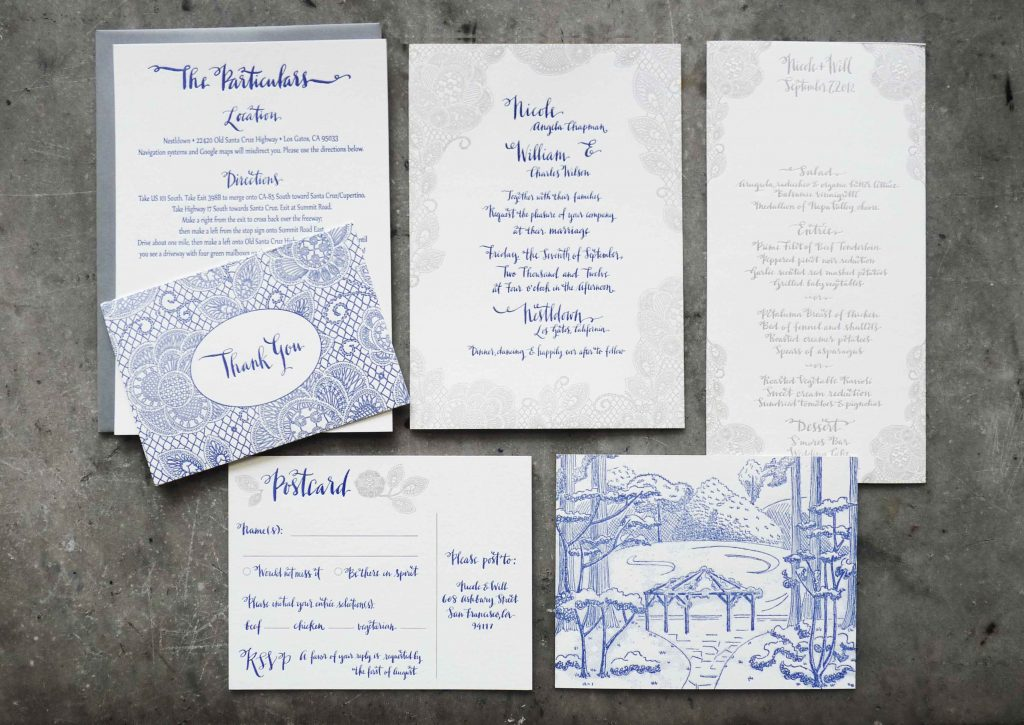 This is an elaborate letterpress wedding invitation suite with gray and blue mandala-like illustrations, a landscape drawing, and playful modern calligraphy lettering.