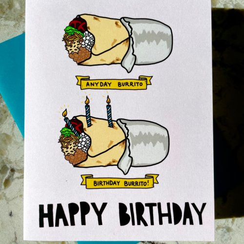"Full-color image of an everyday burrito and a label saying ""everyday burrito"" and below that another almost identical burrito with a couple of candles and a label that reads ""birthday burrito"" on a white folding card"