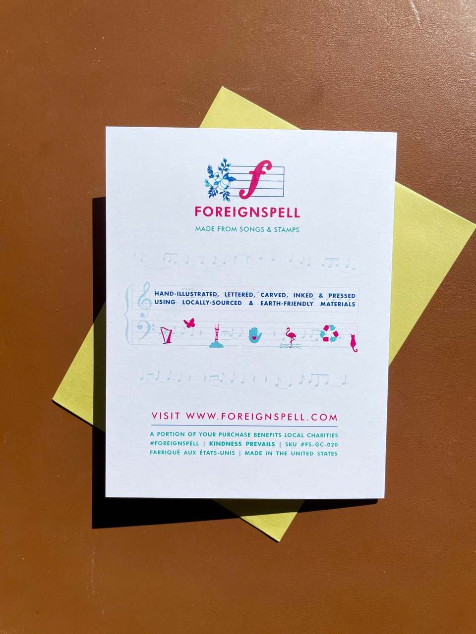 Back of greeting card with information on the design studio, Foreignspell
