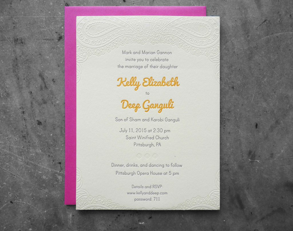 A letterpress wedding invitation with blind (no ink) deboss (embossing) of a paisley pattern reminiscent of those used for henna tattoos. The names are printed in a bright, deep goldenrod yellow. Pink envelope.