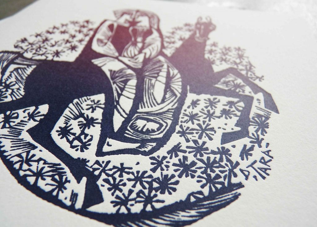 """Detail shot from a unique wedding invitation, folded square card featuring a medieval-style woodcut illustration of two lovers on a horse, with ombre """"rainbow roll"""" colors from blue to purple to burgundy"""