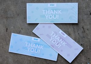 Narrow letterpress thank you cards for the payment processing company Stripe, heavily textured and patterned, in three colors.