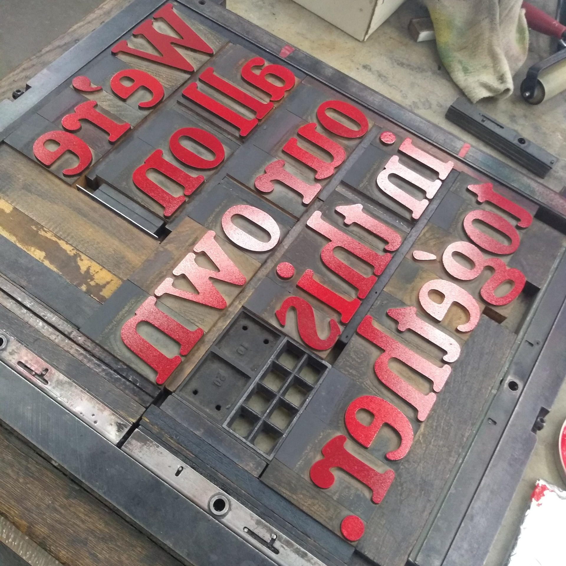 Wood type locked up for printing