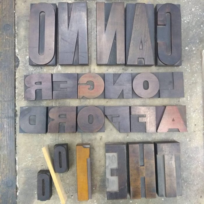"Wood type for a poster saying ""Working people can no longer afford the 1 percent"""