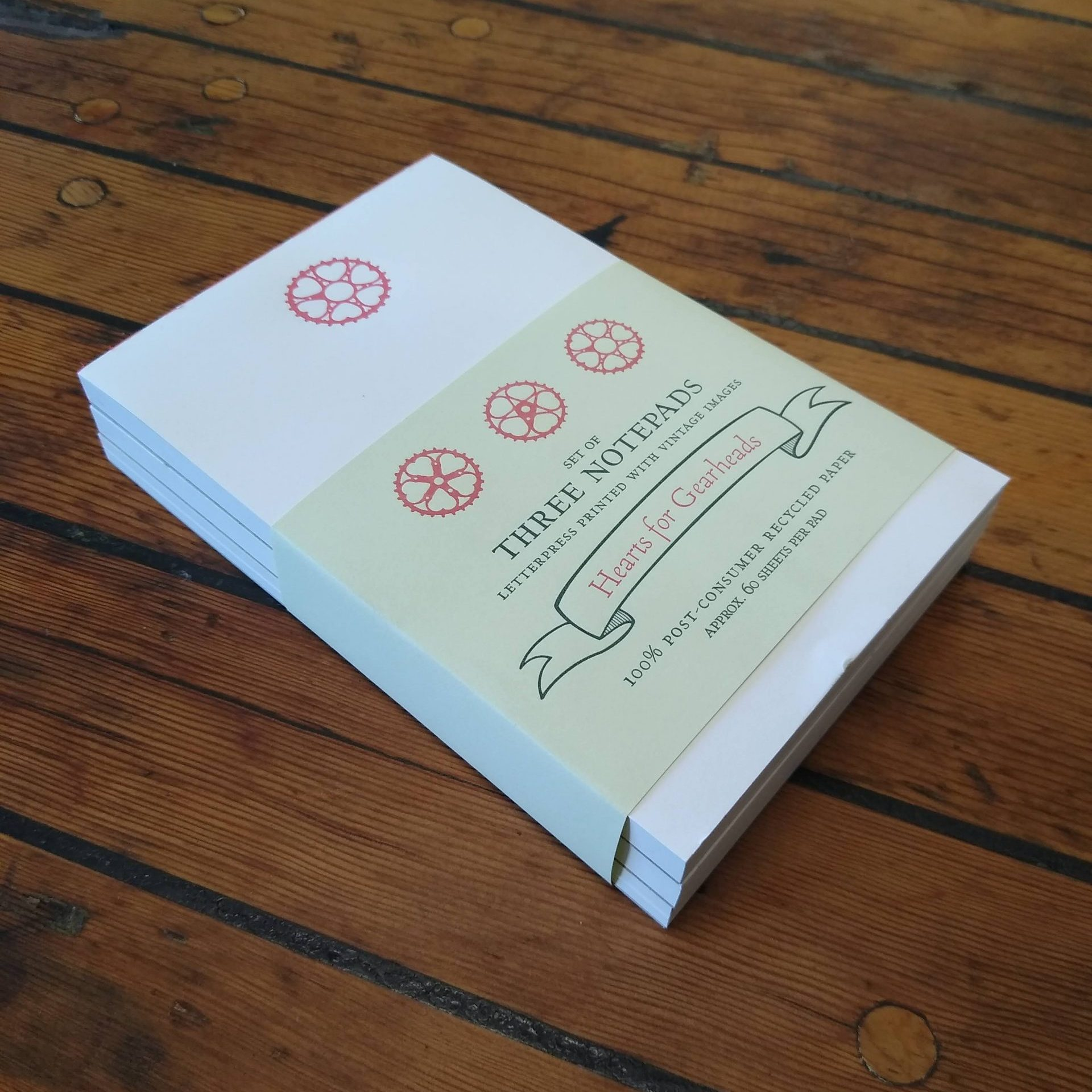 Letterpress printed notepad set with bicycle gear rings featuring sweet hearts