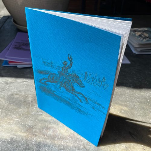 Notebook with turquoise cover letterpress printed with a vintage Pony Express image in antique gold ink