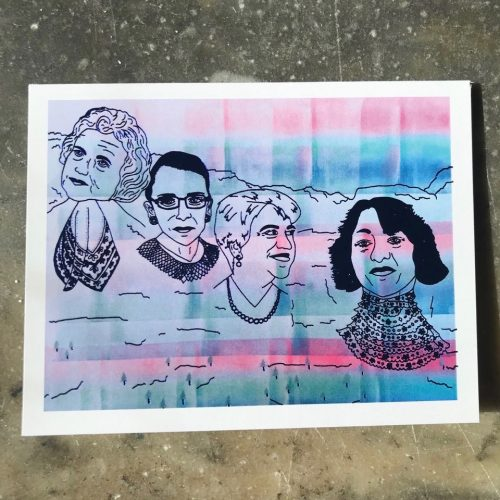 White folding greeting card with pink and turquoise ombre background and metallic blue foil stamp depicting the first four female Supreme Court justices; Sandra Day O'Connor, Ruth Bader Ginsburg, Elena Kagan, and Sonia Sotomayor