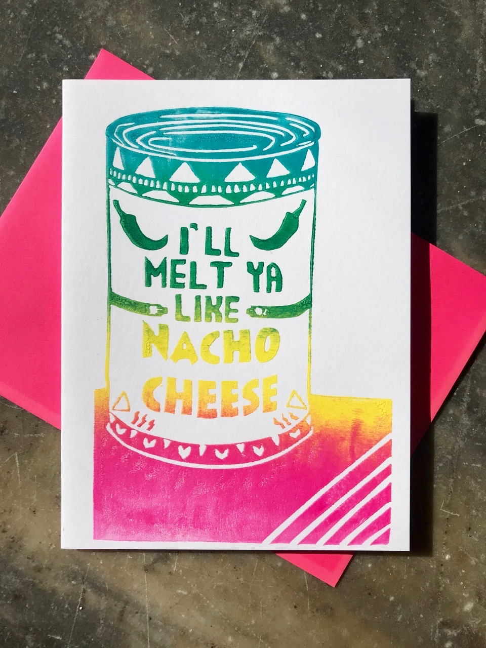 "Green, yellow, and pink ombre illustration that reads ""I'll melt ya like nacho cheese"" on a white folding card"