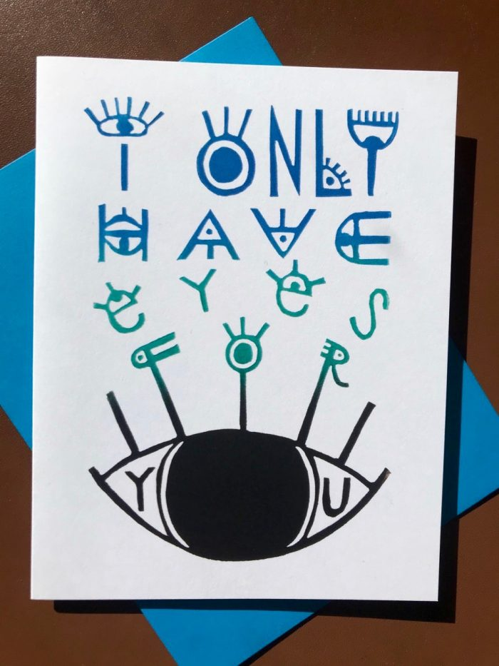 """Hand-lettered design printed in blue, green, and black on a white folding card with lots of eyes illustrated into the words that say """"I only have eyes for you"""""""