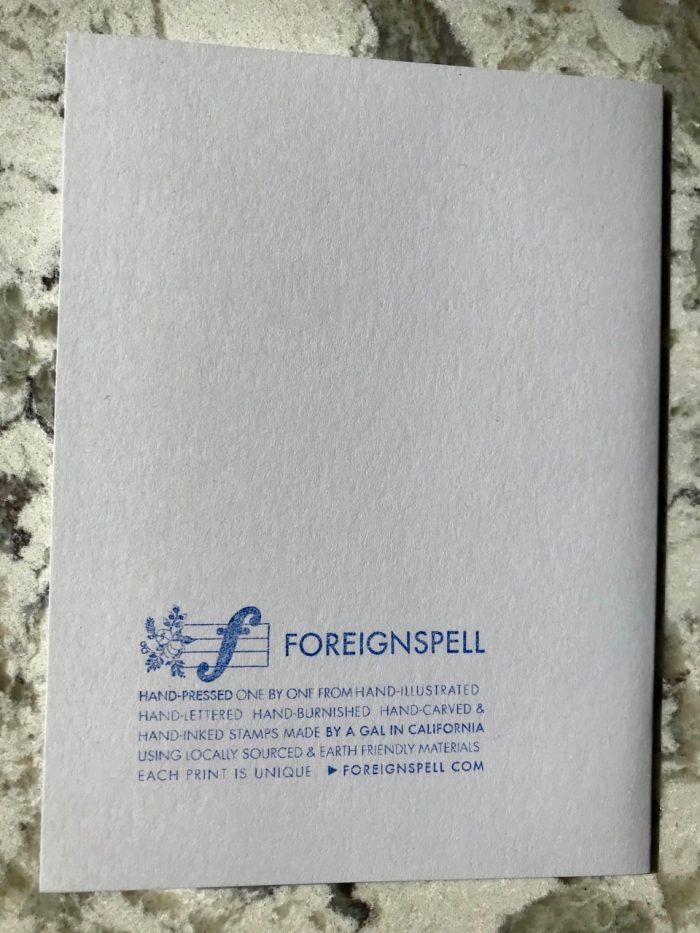 Back of there is love in my rainbow greeting card telling you about Foreignspell, the design studio