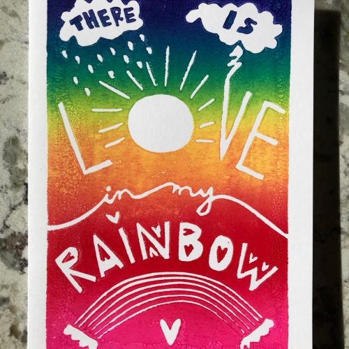 "Rainbow ombre background on white folding card with hand-carved lettering that says ""There is love in my rainbow"""