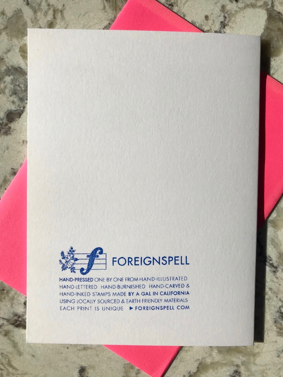 back of greeting card with information on Foreignspell, the design studio