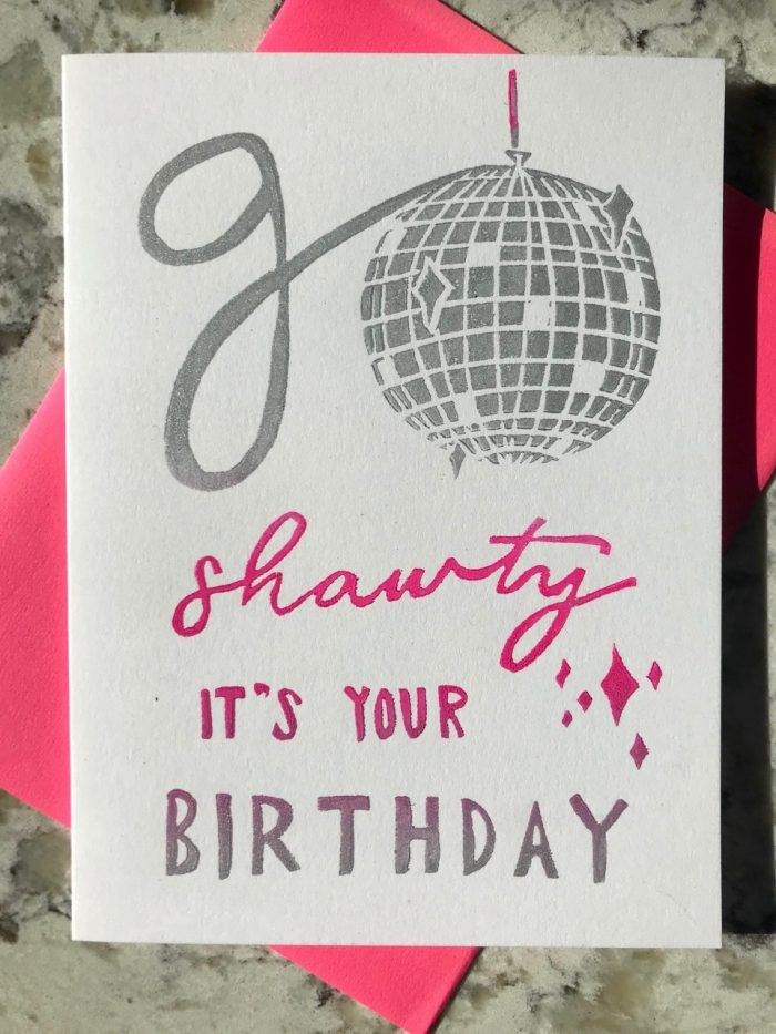 """Silver and pink illustration of a disco ball integrated into hand-lettering that reads """"Go shawty, it's your birthday""""."""