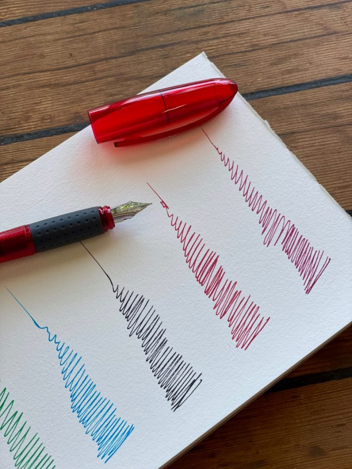 splendid fountain pen with three red ink cartridges