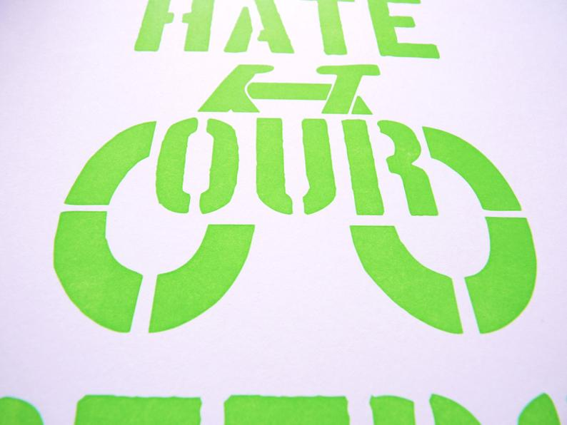 Detail of letterpress printed green ink on white card stock