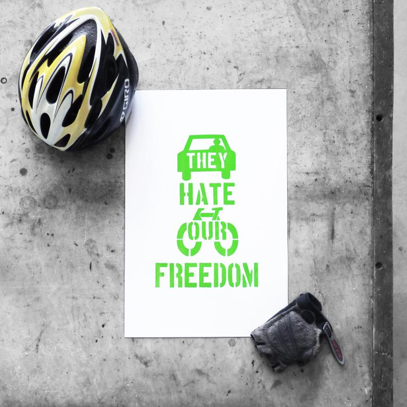 13 by 20 inch poster that says They hate our freedom letterpress printed in fluorescent green ink on white card stock