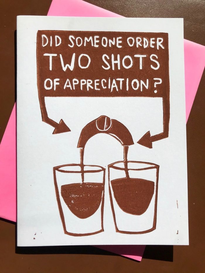 "Brown illustration on white folding card showing two espresso shots being filled and a block above them with the carved-out words saying ""did someone order two shots of appreciation?"""