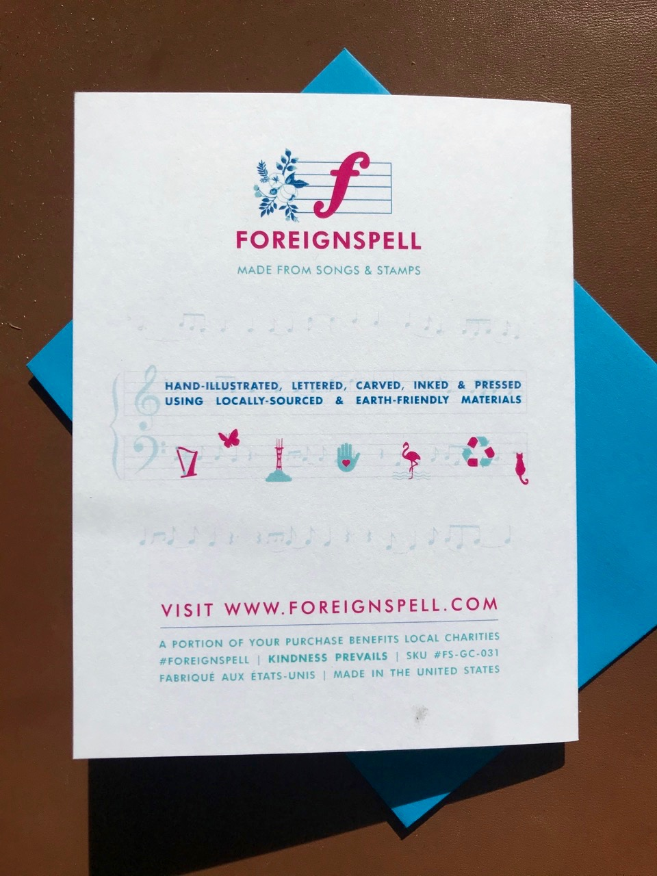Back of greeting card with info on Foreignspell, the design studio