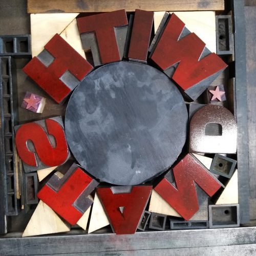 Wood type circle lockup of With Stand text
